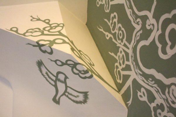 Muurschildering tegen negatieve chi